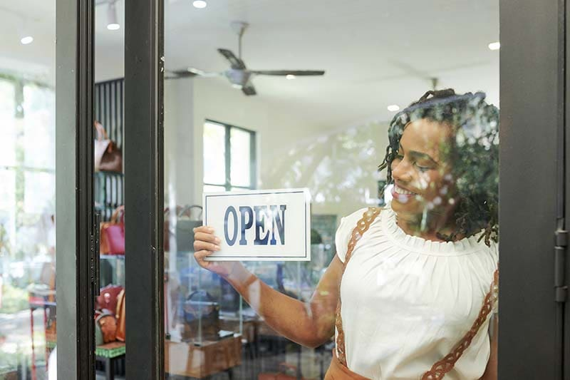 small-business-woman-opening-shop