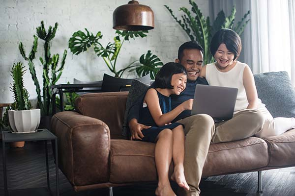 family-at-home-with-laptop